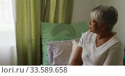 Senior woman in social distancing in her room of retirement house. Стоковое видео, агентство Wavebreak Media / Фотобанк Лори
