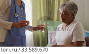 Купить «Nurse helping a senior woman in a retirement home», видеоролик № 33589670, снято 22 ноября 2018 г. (c) Wavebreak Media / Фотобанк Лори
