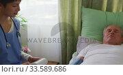 Nurse helping a senior man in retirement house. Стоковое видео, агентство Wavebreak Media / Фотобанк Лори