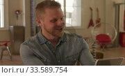 Купить «Caucasian male in social distancing working at home», видеоролик № 33589754, снято 20 июля 2019 г. (c) Wavebreak Media / Фотобанк Лори