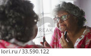 Купить «A senior african american woman spending time at home taking care of herself  social distancing in q», видеоролик № 33590122, снято 12 ноября 2019 г. (c) Wavebreak Media / Фотобанк Лори