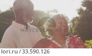 Купить «A senior African American couple spending time together in the garden in love», видеоролик № 33590126, снято 12 ноября 2019 г. (c) Wavebreak Media / Фотобанк Лори