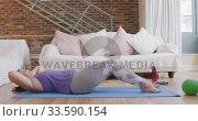 Купить «Caucasian vlogger female exercising at home», видеоролик № 33590154, снято 20 марта 2020 г. (c) Wavebreak Media / Фотобанк Лори