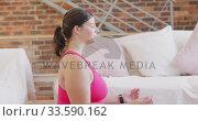 Caucasian vlogger female exercising at home. Стоковое видео, агентство Wavebreak Media / Фотобанк Лори