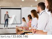 Купить «Side view of student group on lecture», фото № 33606146, снято 25 июля 2018 г. (c) Яков Филимонов / Фотобанк Лори