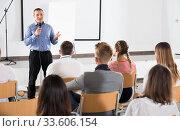 Male teacher lecturing to students. Стоковое фото, фотограф Яков Филимонов / Фотобанк Лори