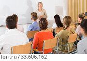 Students listening to lecture of female teacher. Стоковое фото, фотограф Яков Филимонов / Фотобанк Лори