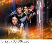 Group adult people playing laser tag game. Стоковое фото, фотограф Яков Филимонов / Фотобанк Лори