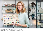 Girl showing pendants. Стоковое фото, фотограф Яков Филимонов / Фотобанк Лори