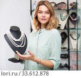 Girl showing pearl necklace on stand. Стоковое фото, фотограф Яков Филимонов / Фотобанк Лори