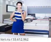 Portrait of customer girl who is shopping in mattress shop. Стоковое фото, фотограф Яков Филимонов / Фотобанк Лори