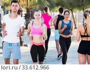 Купить «People jogging on city seafront», фото № 33612966, снято 14 июня 2017 г. (c) Яков Филимонов / Фотобанк Лори