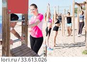 Купить «people doing workout on beach in sunny morning», фото № 33613026, снято 14 июня 2017 г. (c) Яков Филимонов / Фотобанк Лори
