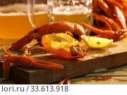 Купить «Crayfish with beer on a wooden table», фото № 33613918, снято 20 апреля 2020 г. (c) Марина Володько / Фотобанк Лори