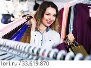 Купить «Female shopper boasting her purchases in underwear shop», фото № 33619870, снято 20 марта 2017 г. (c) Яков Филимонов / Фотобанк Лори