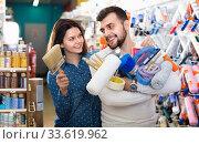Купить «Couple purchasing tools for house improvements in paint supplies store», фото № 33619962, снято 9 марта 2017 г. (c) Яков Филимонов / Фотобанк Лори