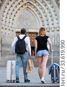 Купить «Energetic man and woman going the historic city center», фото № 33619990, снято 25 мая 2017 г. (c) Яков Филимонов / Фотобанк Лори