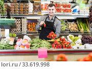 Купить «shopping assistant demonstrating assortment of grocery shop», фото № 33619998, снято 18 марта 2017 г. (c) Яков Филимонов / Фотобанк Лори
