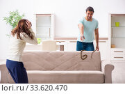 Young couple and snake in the flat. Стоковое фото, фотограф Elnur / Фотобанк Лори