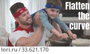 Купить «Caucasian man wearing cape holding his son with words Flatten the Curve during coronavirus covid19 p», фото № 33621170, снято 3 июля 2020 г. (c) Wavebreak Media / Фотобанк Лори