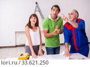 Купить «Young couple and old contractor in home renovation concept», фото № 33621250, снято 2 сентября 2019 г. (c) Elnur / Фотобанк Лори