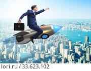 Купить «Businessman flying on rocket in business concept», фото № 33623102, снято 30 мая 2020 г. (c) Elnur / Фотобанк Лори