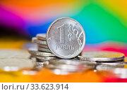 Купить «Российские деньги. 1 рубль среди других монет на ярком разноцветном фоне», фото № 33623914, снято 12 апреля 2020 г. (c) E. O. / Фотобанк Лори