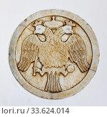Купить «Double-headed eagle - Coat of arms of The Greek Church», фото № 33624014, снято 22 апреля 2018 г. (c) Роман Сигаев / Фотобанк Лори