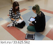 Купить «Middle School Girls Using iPads for Assignment, Wellsville, New York, USA.», фото № 33625562, снято 12 декабря 2019 г. (c) age Fotostock / Фотобанк Лори