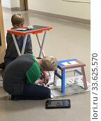 Купить «6th Grade Boys Working on Art Projects, Wellsville, New York, USA.», фото № 33625570, снято 28 октября 2019 г. (c) age Fotostock / Фотобанк Лори