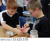 Купить «6th Grade Boys Working on STEM Project, Wellsville, New York, USA.», фото № 33625578, снято 17 декабря 2019 г. (c) age Fotostock / Фотобанк Лори