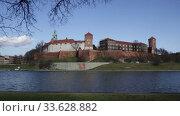 View of medieval Wawel castle on Vistula River at sunny spring day, Krakow, Poland. Стоковое видео, видеограф Яков Филимонов / Фотобанк Лори