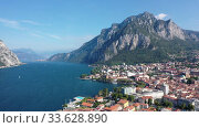 Купить «Colorful mountain scenery with Italian city of Lecco on shore of picturesque Lake Como on sunny day, Italy», видеоролик № 33628890, снято 1 сентября 2019 г. (c) Яков Филимонов / Фотобанк Лори