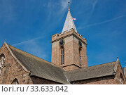 Купить «The Town Church is also known as the Parish Church of St Peter Port in Guernsey during Sunny day with blue sky.», фото № 33633042, снято 4 июня 2020 г. (c) easy Fotostock / Фотобанк Лори