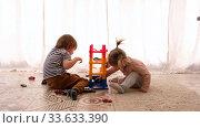 Купить «Children play at home», видеоролик № 33633390, снято 25 апреля 2020 г. (c) Ekaterina Demidova / Фотобанк Лори