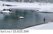Winter swimming in Blue Lakes on Altai river Katun. People bathe in the river water in winter season. Редакционное видео, видеограф Serg Zastavkin / Фотобанк Лори