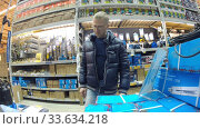 Купить «Ufa, Russia - July 29, 2014: A man is shopping in the Hardware department of the Castorama shop», видеоролик № 33634218, снято 29 июля 2014 г. (c) Mikhail Erguine / Фотобанк Лори