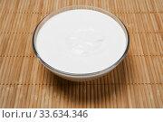 Купить «Bowl with sour cream on the table», фото № 33634346, снято 11 апреля 2020 г. (c) Евгений Харитонов / Фотобанк Лори