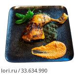 Купить «Chicken drumstick with couscous with black curry, peppers and Romesco», фото № 33634990, снято 31 мая 2020 г. (c) Яков Филимонов / Фотобанк Лори