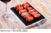 Купить «Bacon wrapped little sausages», фото № 33635062, снято 5 августа 2020 г. (c) Яков Филимонов / Фотобанк Лори