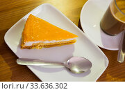 Slice of sponge cake with peach glazing. Стоковое фото, фотограф Яков Филимонов / Фотобанк Лори
