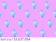 Купить «Pattern from blue latex glove as balloons on hot pink background.», фото № 33637054, снято 21 октября 2019 г. (c) Ярослав Данильченко / Фотобанк Лори
