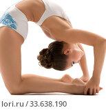 Young female gymnast bending gracefully backwards. Стоковое фото, фотограф Гурьянов Андрей / Фотобанк Лори