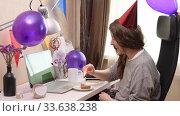Купить «Woman celebrating birthday from home», видеоролик № 33638238, снято 19 апреля 2020 г. (c) Сергей Петерман / Фотобанк Лори