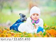 Купить «Little girl in autumn forest, yellow leaves and little girl», фото № 33651410, снято 14 июля 2020 г. (c) age Fotostock / Фотобанк Лори