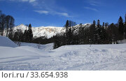 Beautiful mountains covered with snow. Sunny day and blue sky on a frosty day. Стоковое видео, видеограф Олег Хархан / Фотобанк Лори