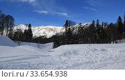 Купить «Beautiful mountains covered with snow. Sunny day and blue sky on a frosty day», видеоролик № 33654938, снято 5 марта 2019 г. (c) Олег Хархан / Фотобанк Лори