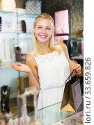 Купить «Woman buying accessorizes», фото № 33659826, снято 6 августа 2020 г. (c) Яков Филимонов / Фотобанк Лори