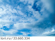 Голубое облачное небо. Blue sky background. Picturesque colorful clouds lit by sunlight. Vast sky landscape panoramic view. Стоковое фото, фотограф Зезелина Марина / Фотобанк Лори