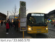 Berlin, Germany, bus line M11 stops in the morning at S-Bahn station Lichterfelde Ost. Редакционное фото, агентство Caro Photoagency / Фотобанк Лори